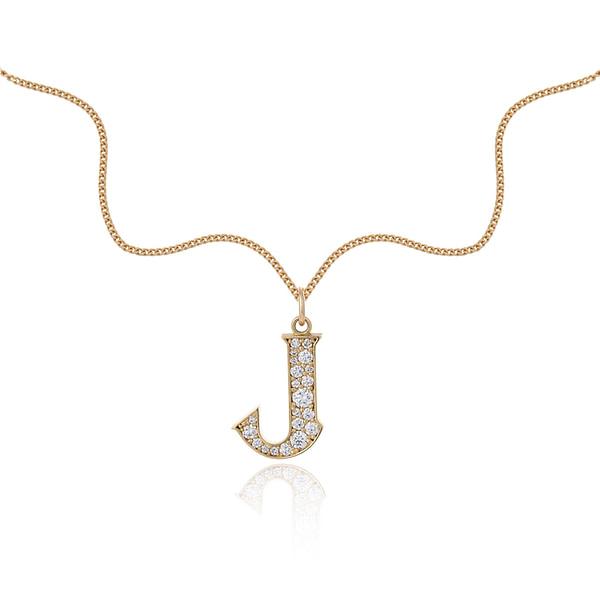 diamond initial pendant in yellow gold
