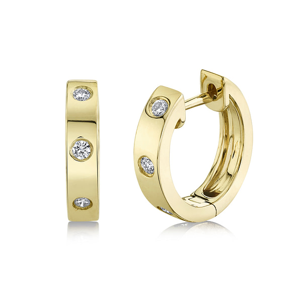 gold and diamond huggie earrings